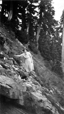 View of a woman standing on a steep slope on Mount Baker