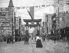[Looking west on Hastings Street from Cambie Street showing the street decorated for the visit of...