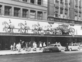 [Coronation display over on the exterior of the Eaton's store]