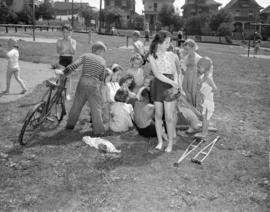 [Group of children playing in a park]