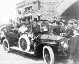 [Mayor L.D. Taylor and Sir Wilfrid Laurier in car, greeted by members of the public]