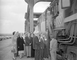 [Group of people gathered at a CNR locomotive]