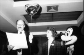 Mike Harcourt, unidentified woman and Mickey Mouse