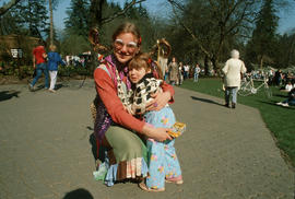 Woman and child in costumes during Centennial birthday celebration at Stanley Park