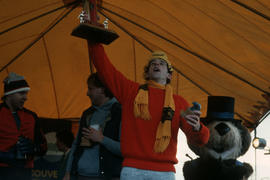 Man holding awards on stage at Polar Bear Swim