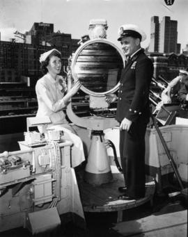 Miss P.N.E. contestant with sailor by signal lamp aboard the H.M.S. Sheffield