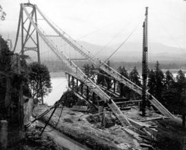 Erection of the first sections of steel for the roadbed where it enters Stanley Park.  Sections s...