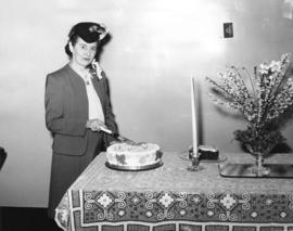 [Mrs. Margaret McNeil cuts the birthday cake sent from Vancouver, B.C.]