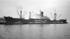 M.S. Yamashita Maru [at dock, with lumber-filled barges alongside]