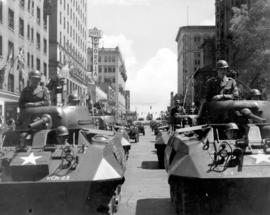 [Military tanks and Jeeps travelling west on Georgia Street in the Diamond Jubilee Parade]