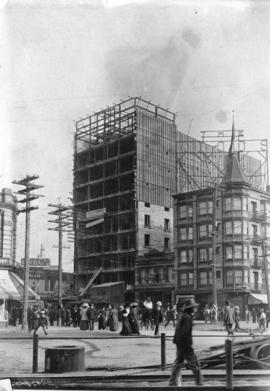[The Holden Building under construction at 16 East Hastings Street]