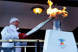 Day 90 Torchbearer 8 Fred Green lights the cauldron on board a canadian Pacific Train in Craigell...
