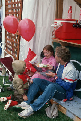 Family eating food during the Centennial Commission's Canada Day celebrations