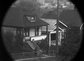 Telephoto [shot of] Snell's cottages