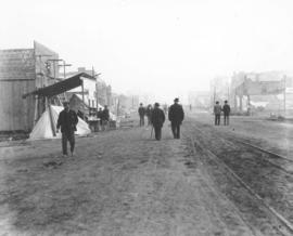 [Men walking down] Columbia St., New Westminster [after fire of] Sept. 1898