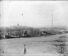 [View of Victoria, B.C., showing residences and commercial buildings in foreground, and Parliamen...