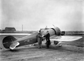 [James Wedell and William Templeton beside Wendell Williams Air Service Incorporated airplane]