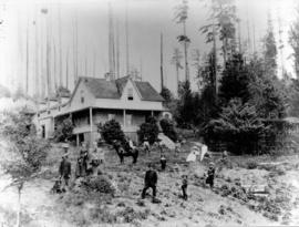 [A group in front of the McCleery farmhouse]
