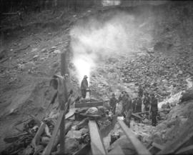 [Men operating monitor in borrow pit of Coquitlam Dam]