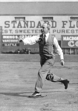 [Mayor L.D. Taylor throwing baseball at opening of baseball season]