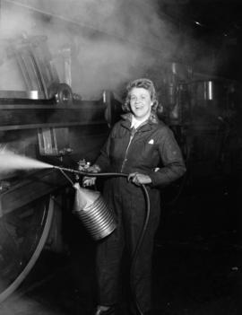 C.P.R. [Pearl Olsen cleaning Royal Hudson Locomotive]