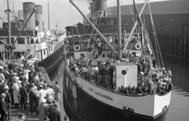 "[The ""Lady Alexandra"" with decks crowded with people nears the Union Steam Ship dock]"