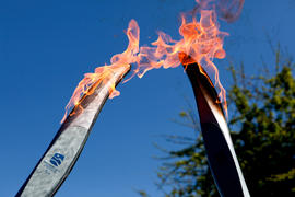 Two Paralympic torches pass the flame in Victoria, BC
