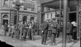[Men assembled outside the office of the World newspaper, at Hastings and Richards Streets]