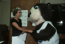 Tillicum shaking hands with a Vancouver City Hall employee