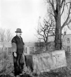 Man standing beside old granite trough in Mount Pleasant