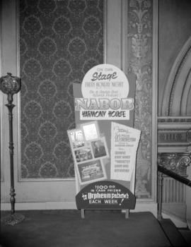 [Advertising board for Nabob's 'Harmony House' at the Orpheum]