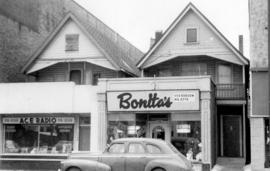 [Exterior of businesses attached to the front of houses - 1130 and 1132 Robson Street]