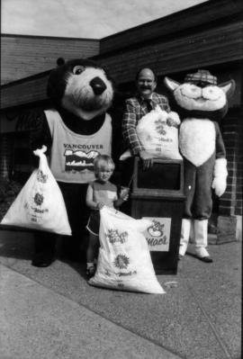 Tillicum, Mike Harcourt, MacTavish and child holding plastic bags