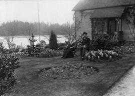 Stanley Park [with Mr. Elder, Park Superintendent and his wife, in front of their cottage at entr...