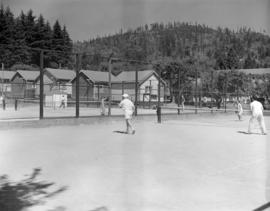 [People playing tennis on courts at Bowen Island]
