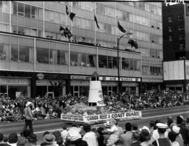 """Canada Needs a Coast Guard"" float in 1959 P.N.E. Opening Day Parade"