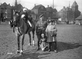 231st on parade [officer with family - child on horseback]