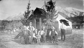 [Men of the Crow's Nest Pass Lumber Co. in front of dwelling on Christmas Day]