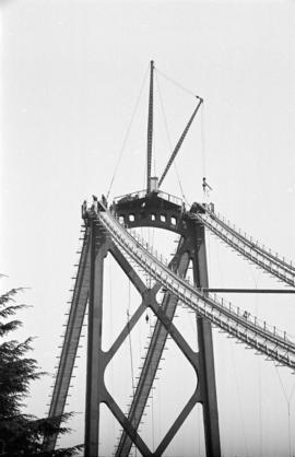 [Catwalks up to a tower of the Lions Gate Bridge under construction]