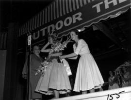 Winner of Miss Vancouver 1955 receiving sash on Outdoor Theatre stage