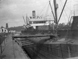 [A whaleback ship at dock]