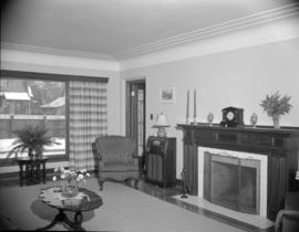 [Interior view of a house showing the living room with fireplace]