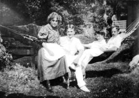 Lois and Ruth Purdy and two unknowns [in hammock]