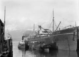 "[""Indo Maru"" at dock]"