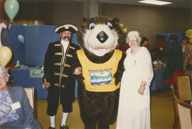 Actor in Captain George Vancouver costume, Tillicum and elderly woman