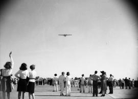 [Crowd watching the inaugural flight of the first bomber produced at the Boeing plant on Sea Island]