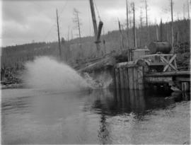 [Dumping logs into the water for] Pacific Mills [on the] Queen Charlotte Islands