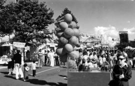 Balloon vendor and crowd on P.N.E. grounds