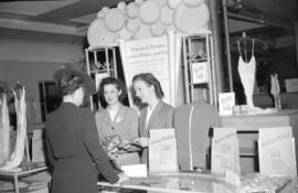 [Store clerks helping woman at Lux soap display in Spencer's Department store]