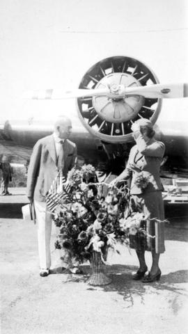Sea Island airport - United Airlines stewardess Dorethea Bow hands flowers to L.D.T. [Mayor L.D. ...